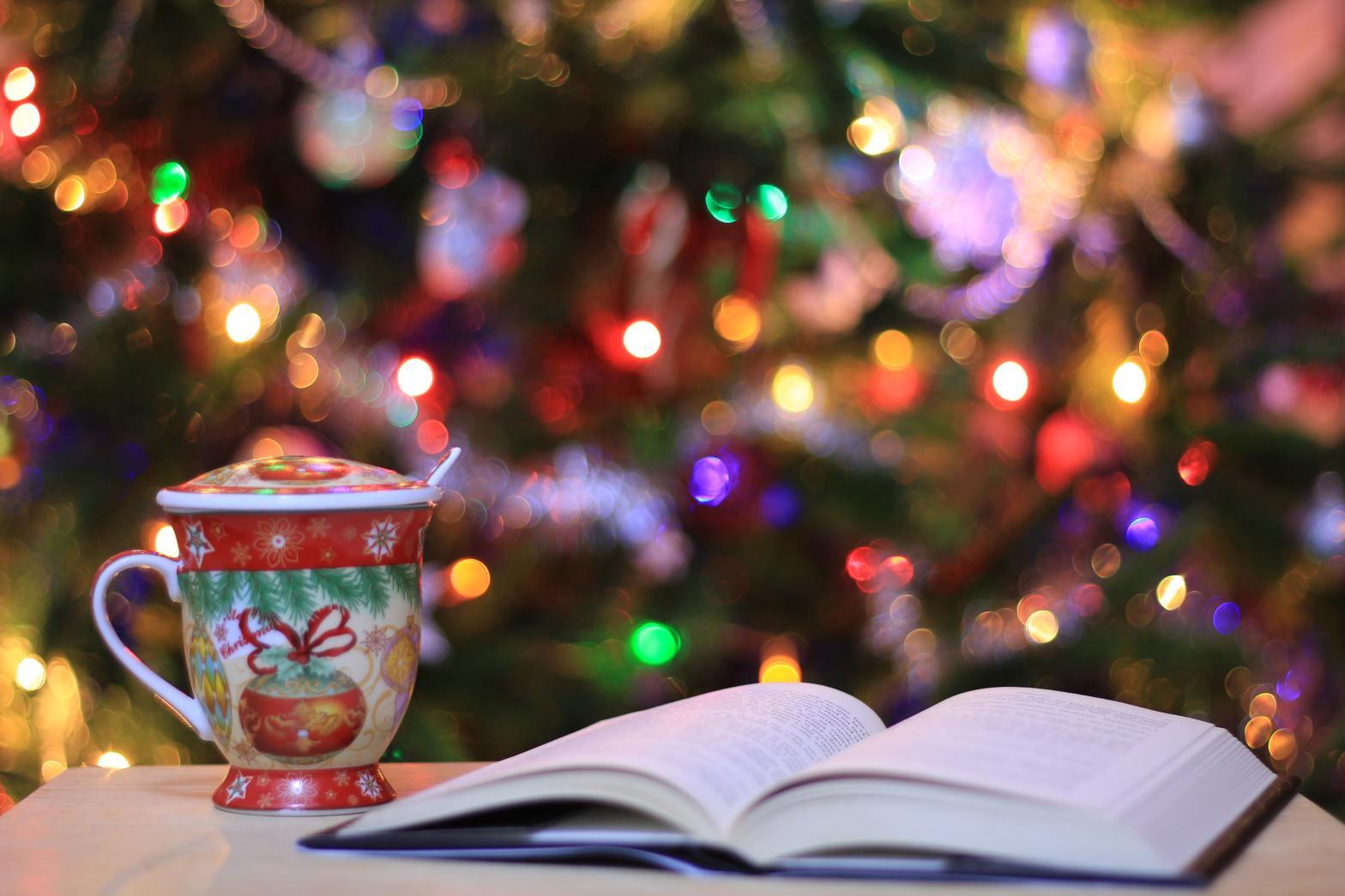 Book, mug, and Christmas tree